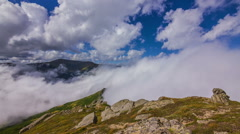 Timelapse of beautiful summer landscape in mountains with clouds passing by Stock Footage