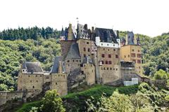 Castle eltz on green hill above mosel river Stock Photos