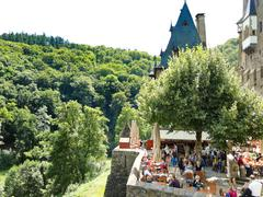 tourists in castle eltz above mosel river, germany - stock photo