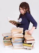 Teenager reads books Stock Photos