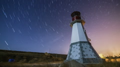 Timelapse of beautiful night landscape with lighthouse in the field with Stock Footage