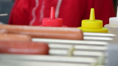 Hot dogs roller maker in hotdog diner - stock footage