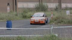 Orange Rally Car racing Around track Arkistovideo