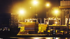 Timelapse of trading port activity at night time - stock footage