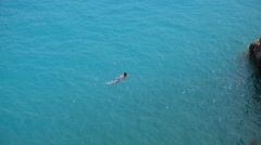 Man swimming alone in large turquoise sea water , feeling free 4K Stock Footage