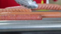 Commercial hot dog roller grill cooker in fast food lunch dinner - stock footage