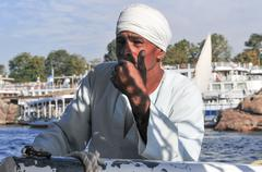 egyptian nubian on a felucca - stock photo