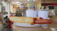 Stock Video Footage of Hotdogs and drinks for lunch in petrol station convenience store