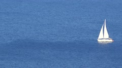 White sail boat offshore on blue sea, aerial view 4K Stock Footage