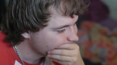 Bored Young Man Looks At Monitor Stock Footage
