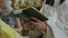 Orthodox priest reads prayer together with christians in Russian Church Stock Footage