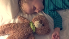 Little boy and teddy bear toy sleeping upside-down  Stock Footage