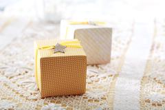 Hand-crafted gift boxes with star-shaped labels Stock Photos