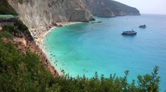 Panorama beach, ships, cliff, trees, people, turquoise sea water Stock Footage