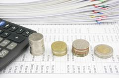 Pile coins and calculator place on finance account Stock Photos