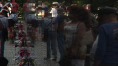 Reflection of visitors to the Vietnam Veteran Memorial Wall Stock Footage