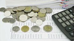 Stock Video Footage of Counting coins on finance account and calculator time lapse