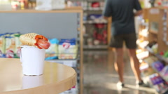 Order hot dog and coffee cup in convenient store Stock Footage