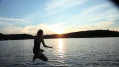 10 YEAR OLD GIRL JUMPS IN LAKE 2 Stock Footage