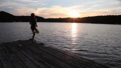 10 YEAR OLD GIRL JUMPS IN LAKE 1 Stock Footage