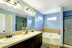 blue bathroom with tile trim - stock photo