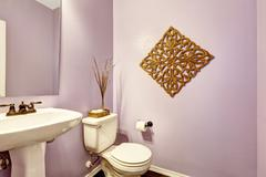 Light purple bathroom with white washbasin stand Stock Photos