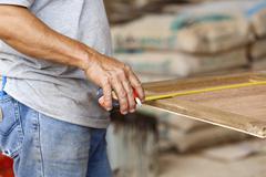 Carpenter make new furniture for house Stock Photos