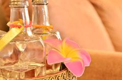 Essence of flower - glass bottle with pink flower Stock Photos