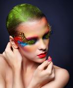 woman with fashion feather eyelashes make-up - stock photo