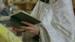 Orthodox priest prayed together with church believers Stock Footage