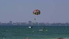 Summer beach recreational activities parasailing - stock footage