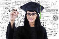 Female student writing math formulas Stock Photos