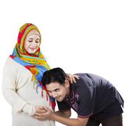 happy islamic family waiting childbirth - stock photo