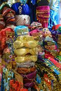 colorful fez hats and slippers clothing in istanbul turkey - stock photo