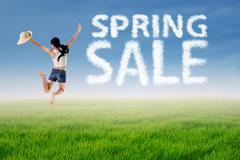 woman jumps with spring sale cloud - stock illustration