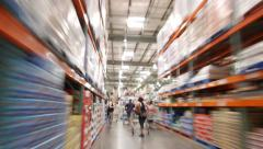 Stock Video Footage of POV shopping walk through big warehouse store. Timelapse view, blurred motion.