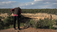 Photographer at Cliff Palace Indian Dwelling Mesa Verde 4K 104 Stock Footage