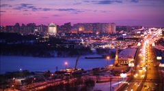 Moscow panorama at dusk. Traffic on Leningradskoe Shosse bridge. Moscow, Russia. Stock Footage