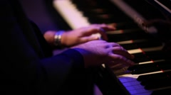 Male pianist hands playing piano. Closeup, shallow DOF. Stock Footage