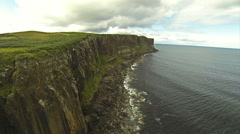 Flying over  Kilt Rock waterfall in Isle of Skye in Scotland on a summer day Stock Footage