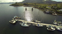 Flying over a small port in Isle of Skye in Scotland on a summer day Stock Footage