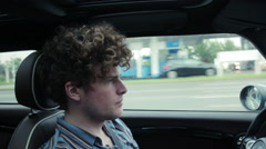 Young man driving to the autobahn - stock footage
