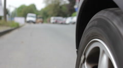 Detail of moving car wheel Stock Footage
