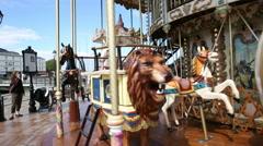 FRANCE, HONFLEUR - JULY 21, 2014: people in Honfleur old town vintage carousel Stock Footage
