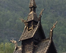 NORWAY: Borgund Stave Church, overhanging shingle roof with carved dragon heads Stock Footage