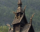 Stock Video Footage of NORWAY: Borgund Stave Church, overhanging shingle roof with carved dragon heads