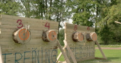Four log boards with three axes on each Stock Footage