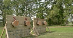 Three axe have been thrown to the log boards Stock Footage