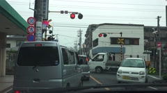 Car Traffic Jam As Train Pass Japanese Rail Crossing 4K Stock Footage