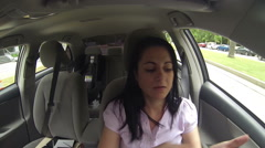 Woman applying cream on her body in the car Stock Footage